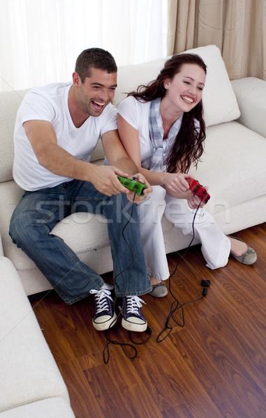 Paar spelen video games woonkamer gelukkig glimlach Stockfoto © wavebreak_media
