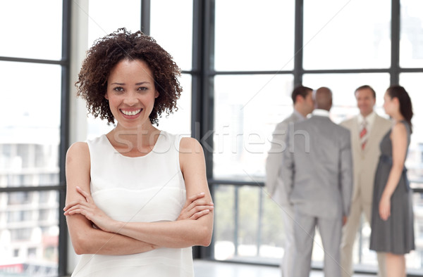 Lively businesswoman on phone in office with her team Stock photo © wavebreak_media