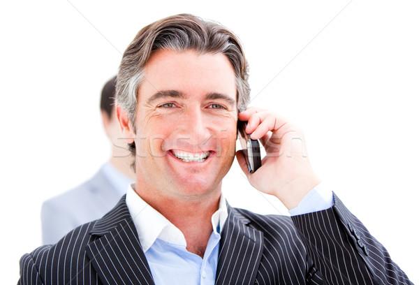 Souriant affaires parler téléphone blanche bureau Photo stock © wavebreak_media