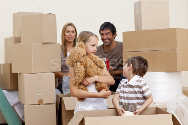 Family moving house playing with boxes Stock photo © wavebreak_media