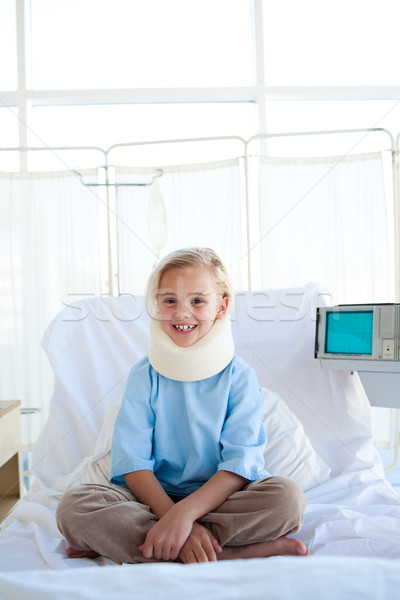 Smiling girl sitting on a hospital bed  Stock photo © wavebreak_media