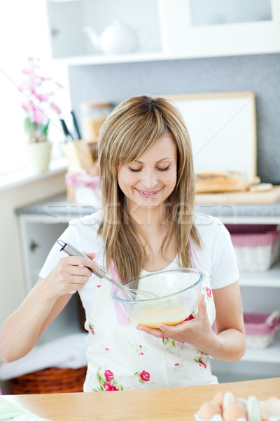 Cheerful woman preparing a meal in the kitchen  Stock photo © wavebreak_media