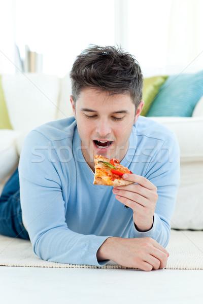 Jonge man eten pizza grond gelukkig gezondheid Stockfoto © wavebreak_media