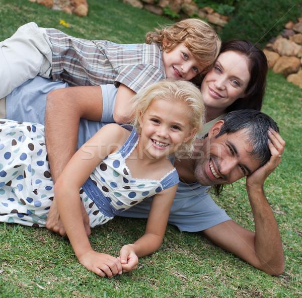 Szeretetteljes fiatal család napsütés nő mosoly Stock fotó © wavebreak_media