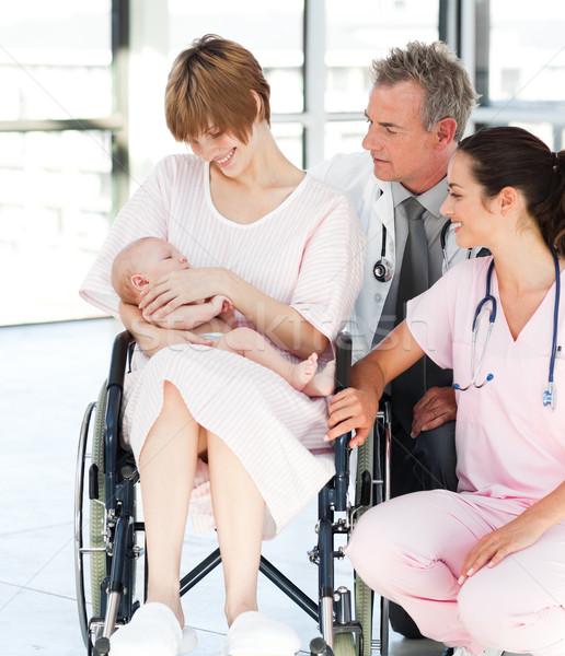 Patient with her newborn baby and doctors in hospital Stock photo © wavebreak_media