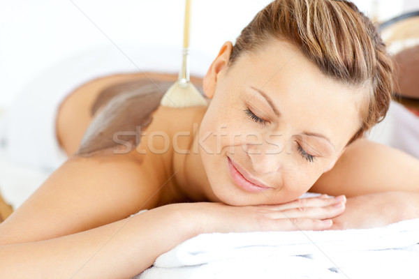 Relaxed young woman enjoying a beauty treatment with mud in a health spa Stock photo © wavebreak_media