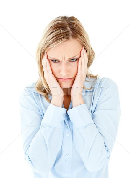 Downcast businesswoman taking her head between her hands against a white background Stock photo © wavebreak_media