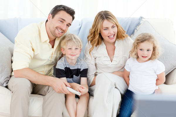 Adorable family watching tv in the living room Stock photo © wavebreak_media