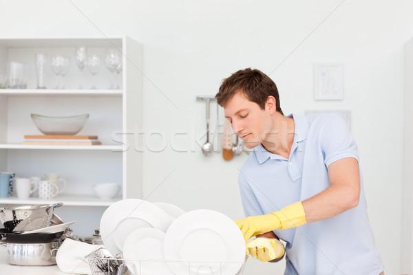 человека мытье посуды кухне воды дома работник Сток-фото © wavebreak_media