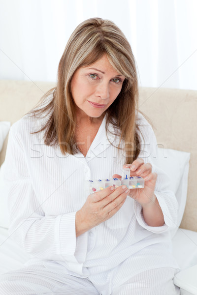 Sick woman taking her pills at home Stock photo © wavebreak_media