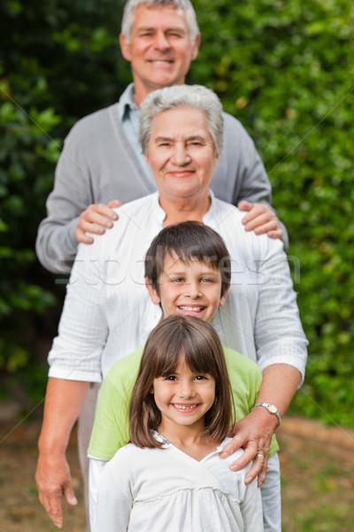 Nagyszülők gyerekek néz kamera kert család Stock fotó © wavebreak_media