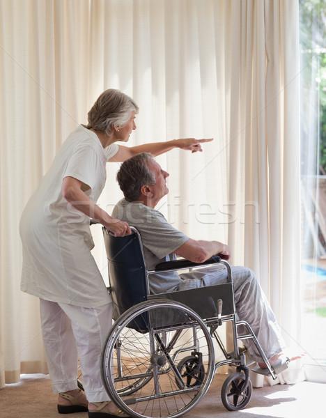 отставку пару глядя из окна женщины Сток-фото © wavebreak_media