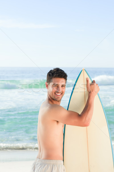 Handsome man beside the sea with his surfboard Stock photo © wavebreak_media