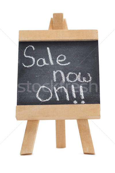 Chalkboard with the words sale now on written on it isolated against a white background Stock photo © wavebreak_media
