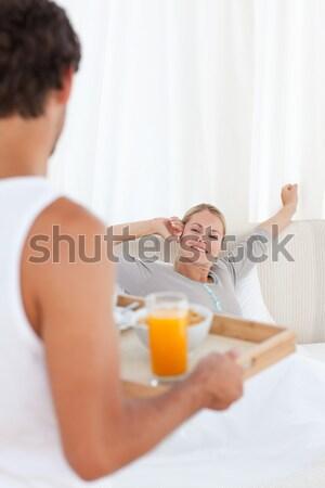 Man bringing breakfast to his sleeping wife in the bedroom Stock photo © wavebreak_media