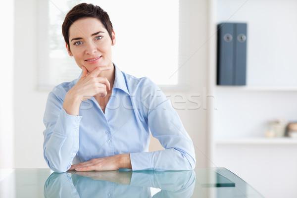 Mosolyog üzletasszony ül mögött asztal iroda Stock fotó © wavebreak_media