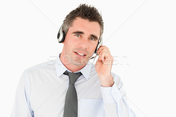 Operator speaking through a headset against a white background Stock photo © wavebreak_media