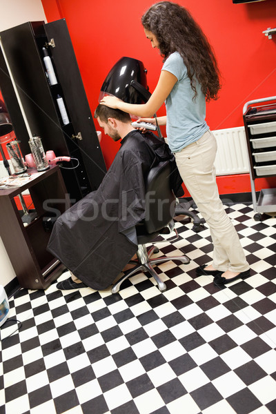 Portrait of a male student having a haircut with a hair clippers Stock photo © wavebreak_media
