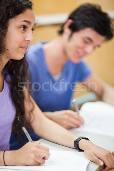 Retrato sorridente estudantes escrita anfiteatro feliz Foto stock © wavebreak_media