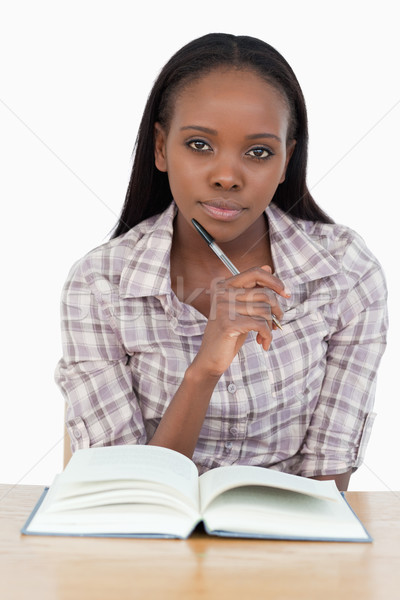 Young woman reading a novel against a white background Stock photo © wavebreak_media