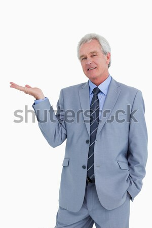 Shocked mature tradesman against a white background Stock photo © wavebreak_media
