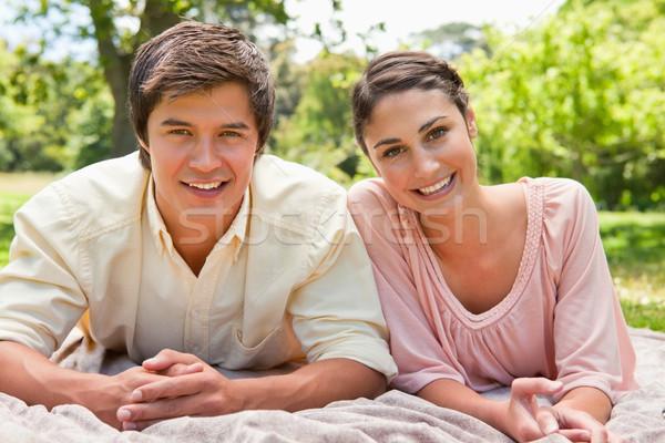 Homem mulher sorrindo topo cinza cobertor Foto stock © wavebreak_media