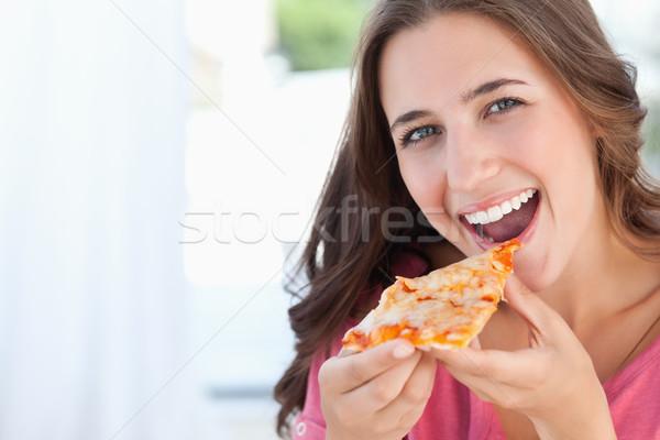 Glimlachende vrouw lippen camera pizza mond Stockfoto © wavebreak_media