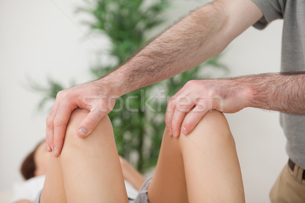 Knees of a patient being held by a doctor in a room Stock photo © wavebreak_media