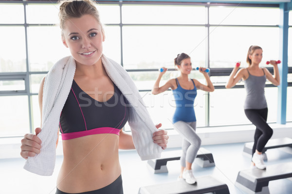 Woman smiling at front of aerobics class in gym Stock photo © wavebreak_media
