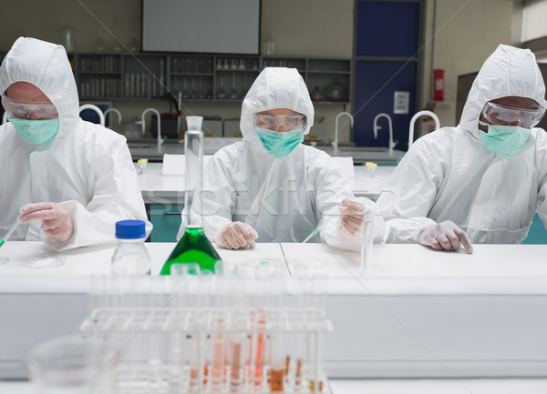 Chemists working in protective suits in the lab Stock photo © wavebreak_media