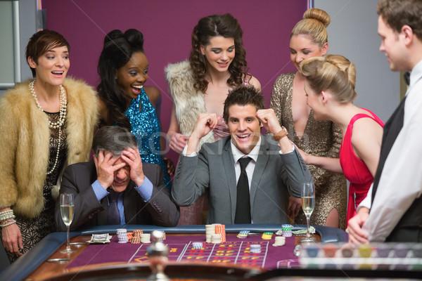 Férfi nyerő másik rulett asztal kaszinó Stock fotó © wavebreak_media