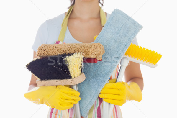 Woman in apron and rubber gloves holding brushes and mops Stock photo © wavebreak_media
