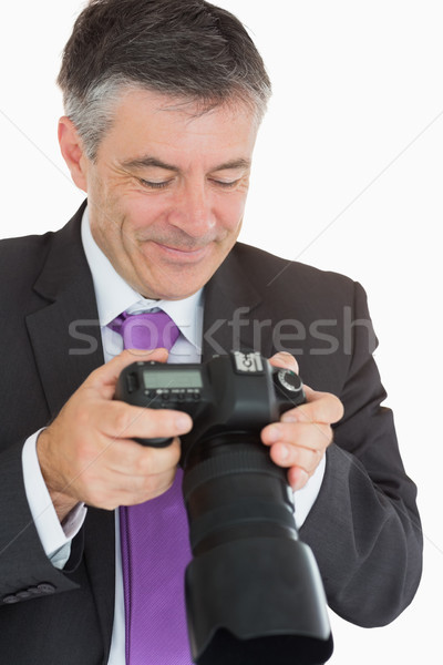 Stock photo: Businessman looking at the camera and smiling