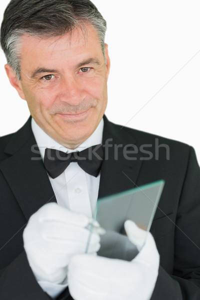 Feliz camarero escrito virtual Screen blanco Foto stock © wavebreak_media
