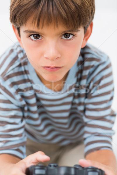 Peu garçon jouer console de jeux enfant Photo stock © wavebreak_media