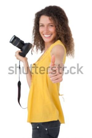 Happy girl holding digital camera Stock photo © wavebreak_media