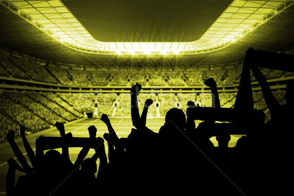 Stock photo: Silhouettes of football supporters
