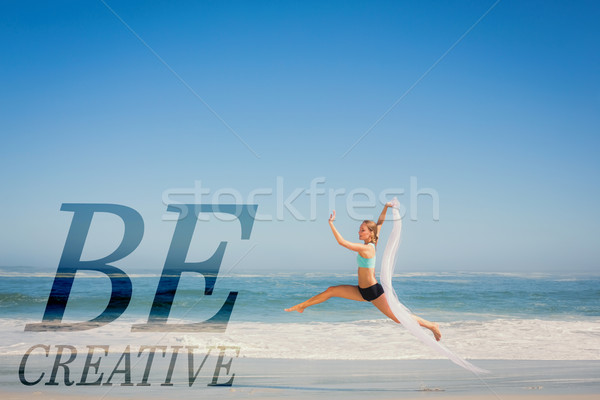 Composite image of fit woman jumping gracefully on the beach wit Stock photo © wavebreak_media