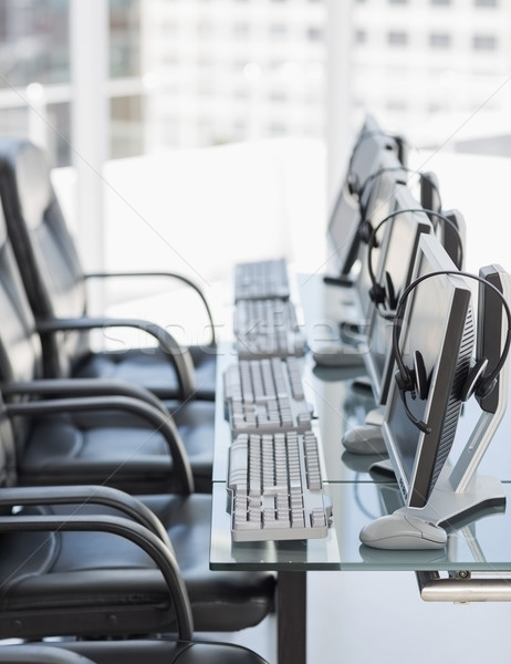 Chairs computers and headset in modern office Stock photo © wavebreak_media