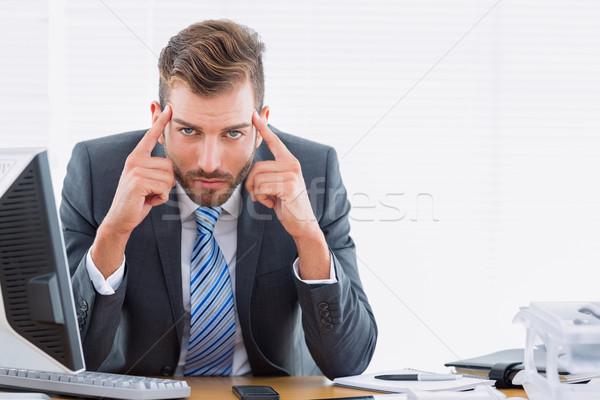 Elegáns üzletember fejfájás irodai asztal portré fiatal Stock fotó © wavebreak_media
