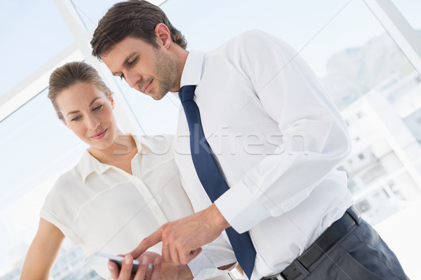 Stock photo: Smartly dressed colleagues looking at mobile phone