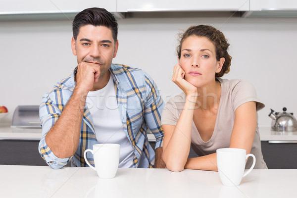 Fed up couple having coffee looking at camera Stock photo © wavebreak_media