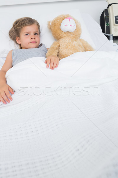 Girl with teddy bear lying in hospital bed Stock photo © wavebreak_media