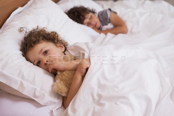 Fiatal lány fiú alszik ágy portré otthon Stock fotó © wavebreak_media