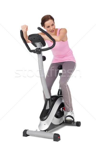 Full length of a beautiful woman on stationary bike Stock photo © wavebreak_media