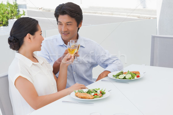 Feliz casal refeição vinho branco fora varanda Foto stock © wavebreak_media