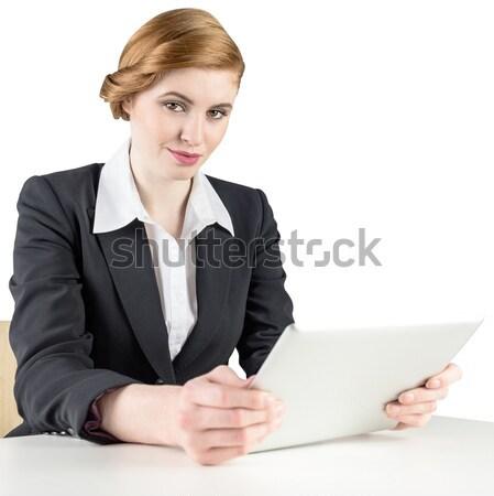 Redhead businesswoman using her tablet pc Stock photo © wavebreak_media
