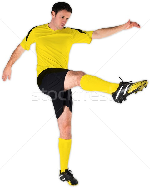 Football player in yellow kicking Stock photo © wavebreak_media