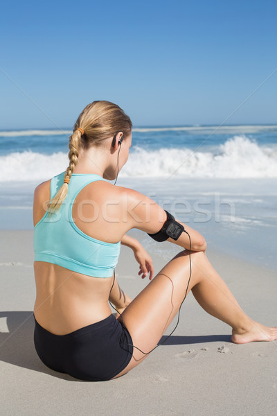 Fit woman sitting on the beach taking a break Stock photo © wavebreak_media