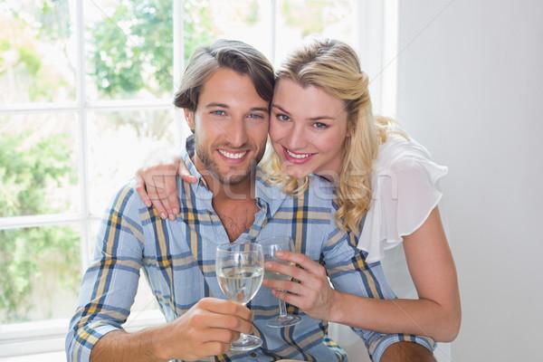 Bonitinho sorridente casal vinho branco juntos Foto stock © wavebreak_media